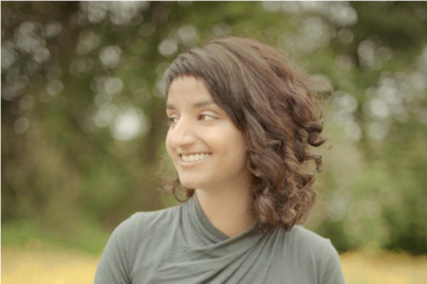 Woman in field smiling
