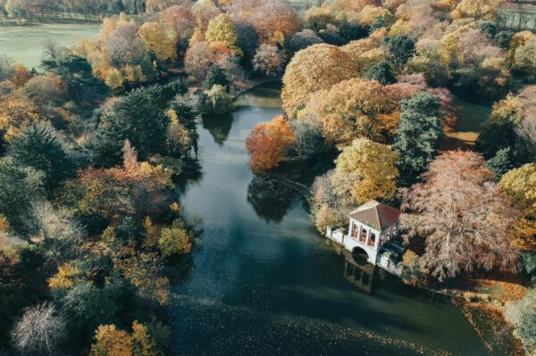 Aerial shot of Birkenhead Park's Serpentine lake and with Roman Boathouse